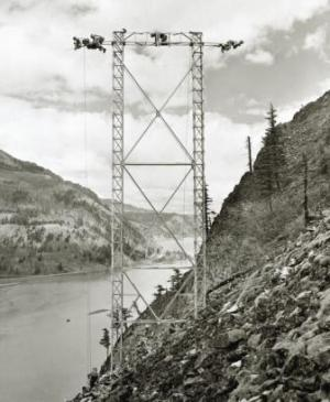 Nostalgic photo of men working on electric tower in Rural California
